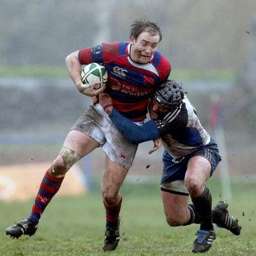 Clontarf's Evan Ryan is tackled by Alex Ryan of Cork Constitution