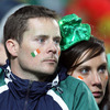 These two Ireland fans look dejected as they reflect on their side's quarter-final exit at the hands of Wales