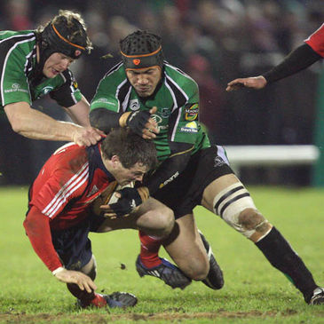 Connacht's Andrew Farley and Ray Ofisa tackle Munster winger Ian Dowling