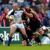 Felipe Contepomi, in his 40th European appearance, looks for support as he is tackled at Murrayfield