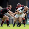 Leinster centre Felipe Contepomi drives forward under pressure from Edinburgh's Allister Hogg and Scott Newlands