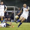Felipe Contepomi tries to add to his and Leinster's points tally, with the assistance of Chris Whitaker
