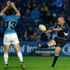Leinster out-half Felipe Contepomi kicks for the corner, over the head of Glasgow centre Max Evans