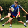 Felix Jones, one of Munster's latest signings, is pictured taking the ball on during Friday's squad session in Cork