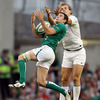 First-time start Felix Jones attempts to gather a high ball, with France's Aurélien Rougerie putting him under pressure