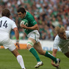 Ireland's new full-back Felix Jones tries to skip away from Aurélien Rougerie, with Maxime Médard awaiting his next move