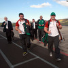 Fergus McFadden and Cian Healy are pictured leading the way as the players and management head to the arrivals hall at Dunedin Airport