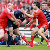 Fergus McFadden keeps a tight hold of possession as he drives forward, with John Hayes and Conor Murray on defensive duty for Munster