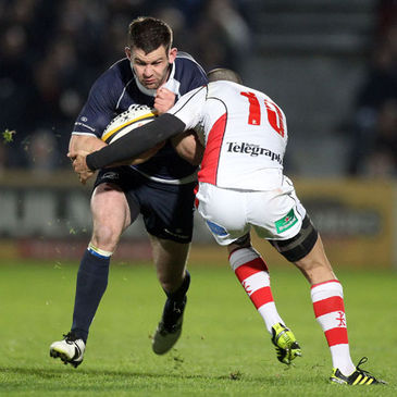 Leinster's Fergus McFadden is tackled by Ulster out-half Ian Humphreys