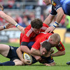 Leinster's Fergus McFadden is brought to ground by the combined efforts of Donnacha Ryan and Keith Earls