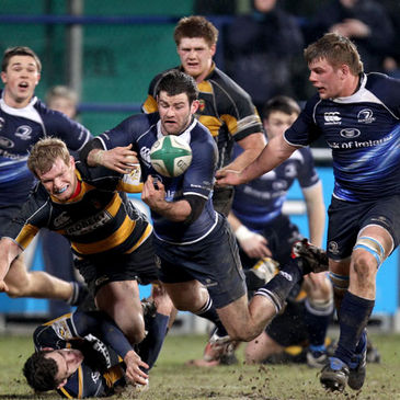 Fergus McFadden offloads under pressure from the Newport cover