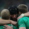 Stephen Ferris hugs wingers Keith Earls and Tommy Bowe just moments before the start of Ireland's first World Cup quarter-final since 2003
