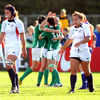 The Ireland players embrace after securing the maximum five points against the USA at Surrey Sports Park