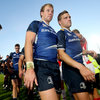 Backs Fionn Carr and Ian Madigan make their way off the RDS pitch after Leinster's first win of the new season