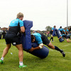 Fionn Carr was on tackle bag duty as his fellow former Connacht player Jamie Hagan took part in a training drill