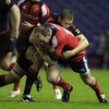 Edinburgh's former Leinster lock Ben Gissing moves in to tackle Munster hooker Frankie Sheahan