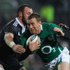 Ireland centre Gavin Duffy tries to escape the grasp of Maori lock Hayden Triggs in Rotorua