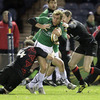 Connacht full-back Gavin Duffy looks for support as he is tackled by Edinburgh's Craig Hamilton and Jim Thompson