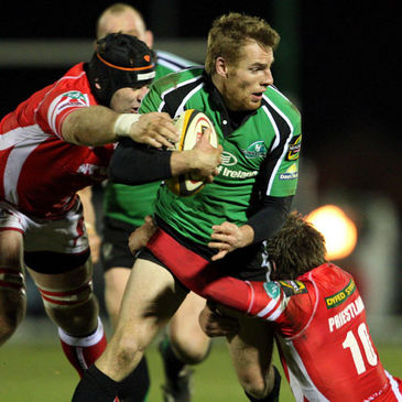 Connacht's Gavin Duffy is tackled by David Lyons and Rhys Priestland