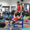 Tamaiti Horua assists as 2009 Lion Stephen Ferris goes through his lifting routine