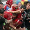 Tommy O'Donnell and Ian Nagle make the hard yards for Munster, with the province's former back rower Nick Williams on defensive duty for Aironi