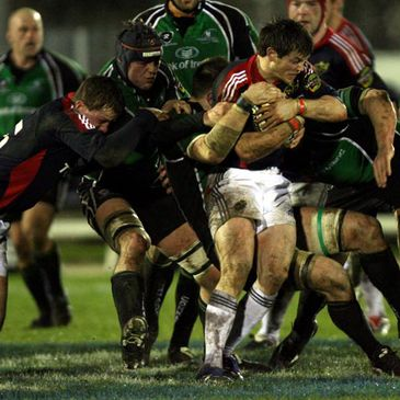 Munster's Ian Dowling holds onto possession against Connacht