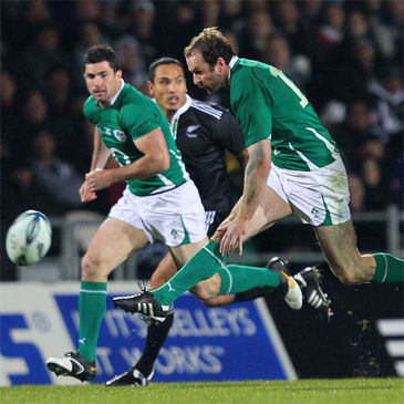 Ireland's captain Geordan Murphy threads a kick through