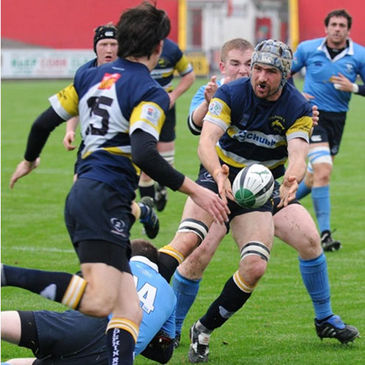 Dolphin flanker George Finn in action against Barnhall