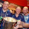 Coaches Jono Gibbes, Joe Schmidt and Greg Feek were given quite a soaking as they tried to pose together for a celebratory photograph