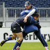 Michael Cheika is on tackle bag duty as full-back Girvan Dempsey crashes into him