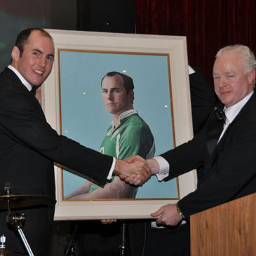 Girvan Dempsey receives a specially-commissioned portrait of himself