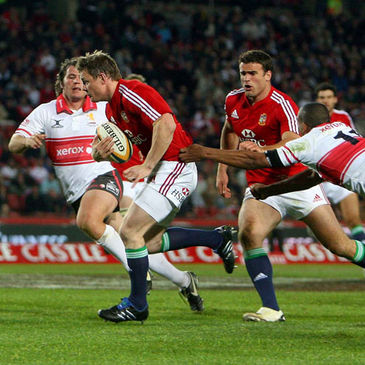 Brian O'Driscoll breaks through to score a try against the Golden Lions