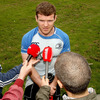 Experienced centre Gordon D'Arcy is pictured taking part in a pitchside interview ahead of the training runout at UCD