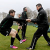 Physiotherapist Keith Fox assists Gordon D'Arcy as he limbers up before the training session in Maynooth