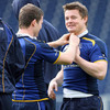 Gordon D'Arcy gets to grips with Brian O'Driscoll's jersey collar during a lighter moment in training