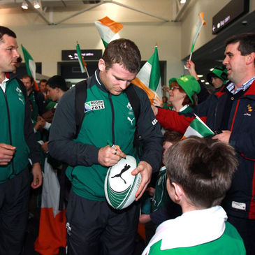 Gordon D'Arcy signs a rugby ball for a young Ireland fan