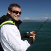 Gordon D'Arcy is shown waiting patiently for a bite as the players tried their hand at fishing near Taiaroa Head