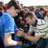 Proud Wexford man Gordon D'Arcy is pictured putting his signature on a young supporter's shirt