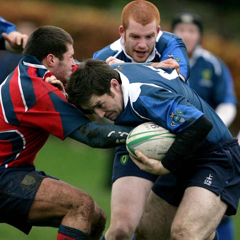 Leinster centre Graham Coffey is tackled by Munster's Shane Hassett
