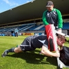 Consultant scrum coach Greg Feek does some one-on-one work with Damien Varley as the players train in the Dunedin sunshine