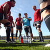 Greg Feek, Ireland's consultant scrum coach, gets his point across as the forwards take a breather at Carisbrook Stadium