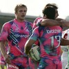 Stade Francais centre Guillaume Bousses is congratulated by his team-mates after scoring the visitors' first try