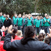 The Ireland players and members of the management look on as pupils from Manukorihi Intermediate School perform a rousing haka