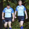 Cian Healy arrives for training with Leinster captain Leo Cullen, who is working his way back from a dislocated shoulder