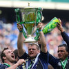 Jamie Heaslip is showered with Heineken as he holds the Heineken Cup trophy high
