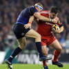 Leinster's stand-in captain Jamie Heaslip is quick to stop Munster's Damien Varley in his tracks