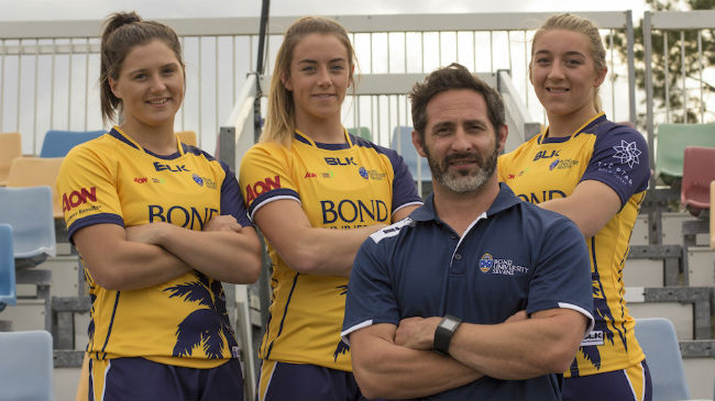 Katie Heffernan, Stacey Flood and Claire Boles with Bond University Sevens coach Ben Gollings