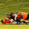 Ed O'Donoghue dons the contact/tackle suit as he, along with Chris Henry and Johne Murphy, takes part in a training drill