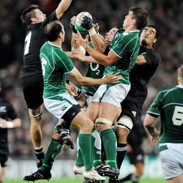 The Ireland and New Zealand players compete for a high ball