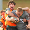 Shane Horgan wrestles for possession with prop Tom Court who won his eight cap in the second half against New Zealand